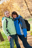 Happy young couple with backpacks in the park Stock Images