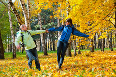 Happy young couple with backpacks in the park Royalty Free Stock Photography