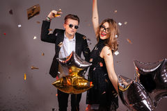 Happy young couple with balloons dancing and having party Royalty Free Stock Photos
