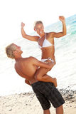 Happy young couple on the beach Stock Images