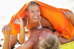 Happy young couple on the beach Stock Photography