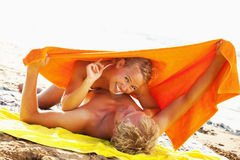 Happy young couple on the beach Stock Photo