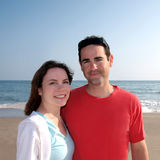 Happy Young Couple On Beach Stock Image