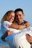 Happy young couple at beach stock images