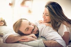 Tenders. Couple in bed. royalty free stock images