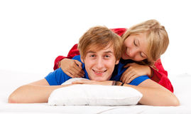 Happy young couple in bedding Stock Images