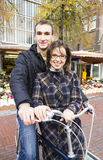 Happy young couple with bicycle near flower market. Happy young couple with bicycle near the flower market Royalty Free Stock Photos