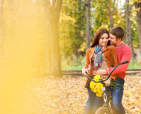 Happy young couple with bicycle Royalty Free Stock Photos