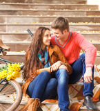 Happy young couple with bicycle walking in autumn Royalty Free Stock Images