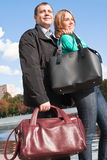 Happy young couple with big bags Stock Photo
