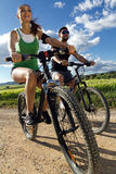 Happy young  couple on a bike ride in the countryside Stock Photography