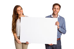 Happy young couple with blank board Royalty Free Stock Photo