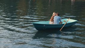 Happy young couple on vacation. Happy young couple in a boat Stock Photos