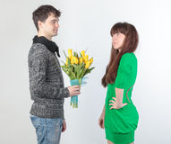 Happy young couple with bouquet flowers Royalty Free Stock Images