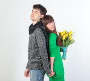 Happy young couple with bouquet flowers Royalty Free Stock Photo
