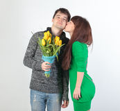 Happy young couple with bouquet flowers Stock Image