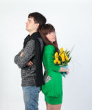 Happy young couple with bouquet flowers Royalty Free Stock Photos
