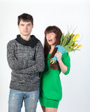 Happy young couple with bouquet flowers Stock Images