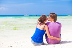 Happy young couple in bright clothes in sunglasses Stock Photography