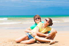 Happy young couple in bright clothes in sunglasses Stock Images