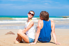 Happy young couple in bright clothes in sunglasses Stock Image