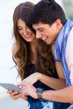Happy young couple browsing internet with digital tablet  in the Stock Images