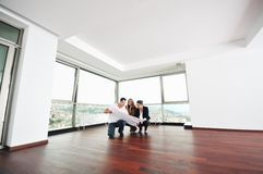 Happy young couple buying home stock photography
