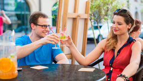 A happy young couple in a cafe. Royalty Free Stock Images