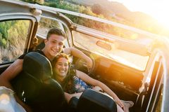 Happy couple in a car royalty free stock photography