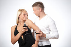 Happy young couple celebrating. A toast Royalty Free Stock Image
