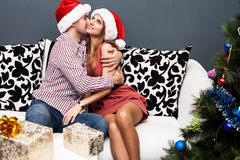 Happy young couple celebrating Christmas Stock Photos