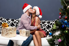 Happy young couple celebrating Christmas Royalty Free Stock Images