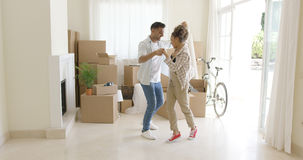 Happy young couple celebrating moving home Stock Photography