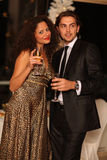 Happy young couple with champagne glasses Royalty Free Stock Image
