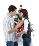 Happy young couple with christmas gifts Royalty Free Stock Image