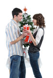 Happy young couple  with Christmas gifts Royalty Free Stock Images