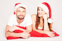 Happy young couple on a Christmas mood Stock Images
