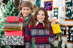 Happy Young Couple In Christmas Store Royalty Free Stock Image
