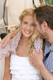 Happy young couple in the city making shopping in summertime. Stock Images