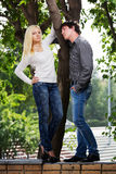 Happy young fashion couple in a city park Royalty Free Stock Images