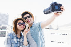 Happy young couple clicking a picture Stock Photo