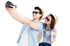 Happy young couple clicking a picture Royalty Free Stock Photography
