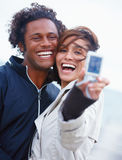 Happy young couple clicking their snap Stock Image