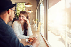 Happy young couple at coffee shop Stock Image