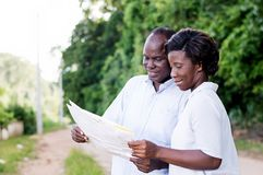 Happy young couple consult a regional map. Stock Image