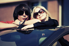 Happy young couple in a convertible car Stock Photo
