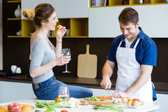 Happy young couple cooking together in the kitchen at home. Stock Photography