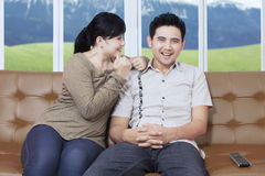 Happy young couple on a couch Stock Photo