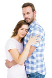 Happy young couple cuddling each other Royalty Free Stock Photos