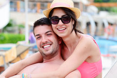 Happy young couple cuddling happy with love on the beach. Happy young couple on summer vacation smiling and hugging Royalty Free Stock Image